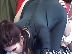 Cheerleader licks ass of babe upon spandex