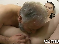 Youthful playgirl blows age-old dick