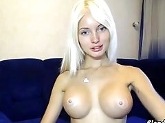 Blonde shows her pussy and plays with a big dildo