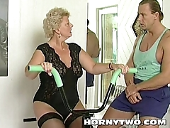Horny granny bitch shamelessly takes gym trainer cock in mouth and fucks him