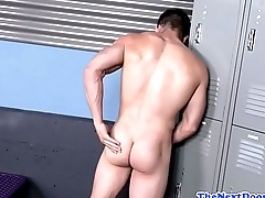 Athletic jock tugging his cock at the gym