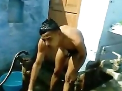 indian boy crumple while bathing